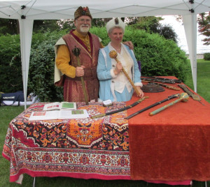 Mr. and Mrs. Kaczor, next to their exhibit with medieval Polish weapons and other historical military artefacts.